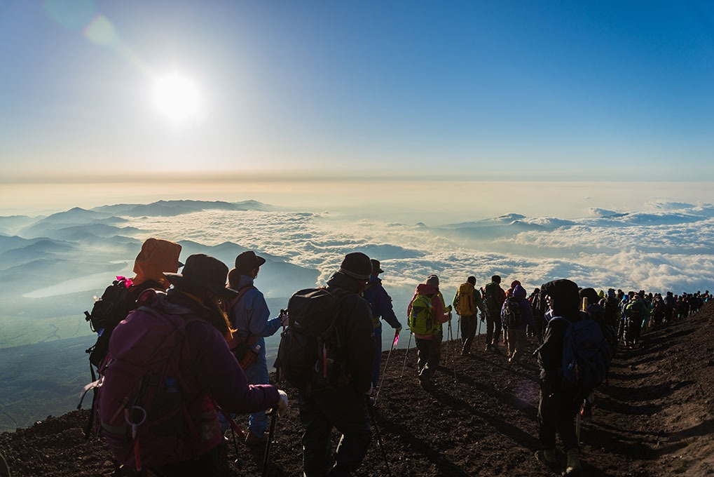 group of people hiking mount fuji